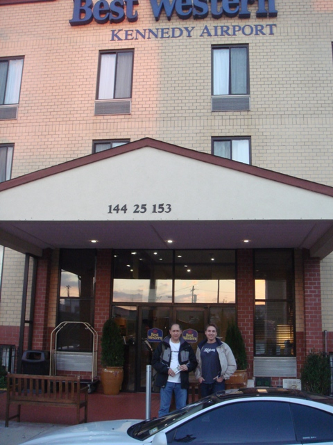 Charl and Chris standing in front of the Best Western hotel in New York