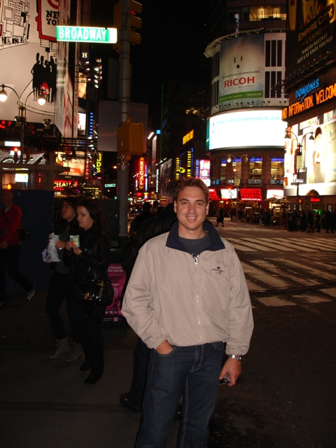 Charl standing at the famous broadway theatre district