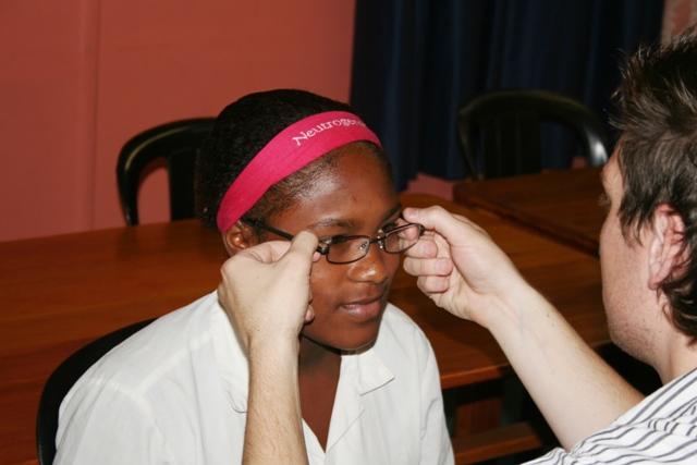 Johann dispensing another pair of glasses.
