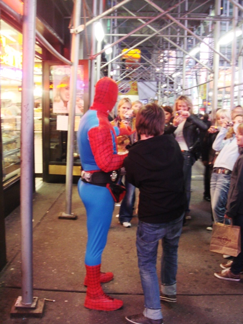Spiderman stopping for a quick photo in Times Square