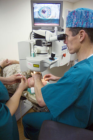 Ophthalmology surgeon lines up the laser_on patients eye before beginning LASIK IntraLase surgery