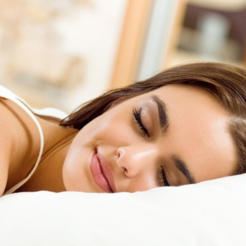 Young girl sleeping with orthokeratology lenses